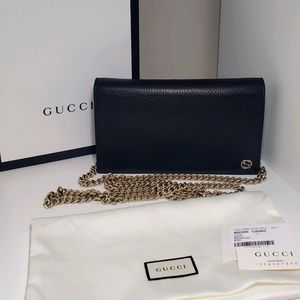 Gucci wallet on chain
